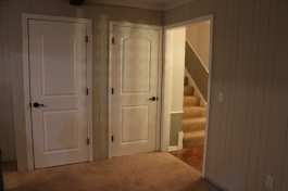 we went for a smooth 2-panel door in the wood panel room