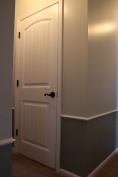 we're using 2-panel doors with additional design throughout the rest of the home