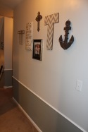 I loved pulling together new and used decor to make this collage wall in the hall